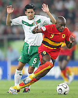 Ricardo Osorio (5) of Mexico avoids contact with Mantorras (9) of Angola. Mexico and Angola played to a 0-0 tie in their FIFA World Cup Group D match at FIFA World Cup Stadium, Hanover, Germany, June 16, 2006.