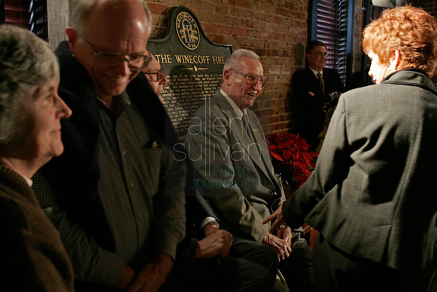 Rick Roberts (cq) (center) at The Spotted Dog--which used to house Fire Station 11--during a commemoration to mark the 60th anniversary of the Winecoff Hotel fire in downtown Atlanta. Roberts, a firefighter at the time who went on to become battalion chief, is credited with helping to save several of the survivors. The fire--at 119 deaths, the worst hotel fire in U.S. history--caused departments across the country to update their fire safety codes.