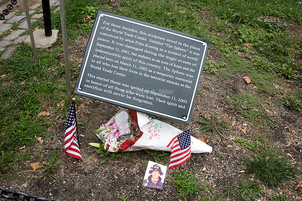 "A memorial left for one of the victims of the September 11th attacks near Fritz Koenig's ""The Sphere"" in Battery Park in New York City, New York on the 10th anniversary of the September 11th attacks on 11 September 2011."