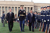 Washington, DC - March 30, 2000 -- United States Secretary of Defense William S. Cohen (left) joins Lt. Col. Charles Sniffin (center), U.S. Army, the commander of troops, in escorting visiting President Hosni Mubarak of Egypt (right) as he inspects the joint services honor guard during a March 30, 2000, ceremony welcoming him to the Pentagon.  Following the full honors arrival ceremony, Mubarak participated in a working breakfast attended by not only senior Department of Defense officials, but also several prominent U.S. senators.  .Mandatory Credit: Robert D. Ward / DoD via CNP.