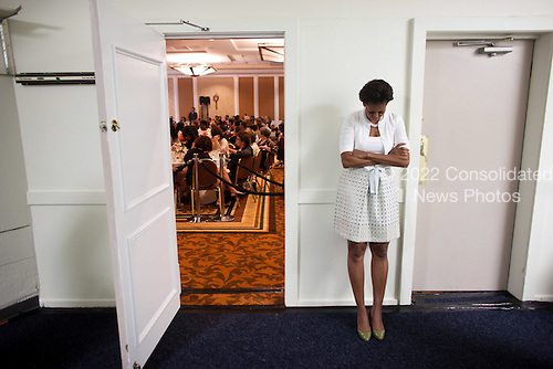 First Lady Michelle Obama waits to be introduced during an event at the Claremont Hotel Club & Spa in Berkeley, Calif., June 14, 2011. .Mandatory Credit: Lawrence Jackson - White House via CNP
