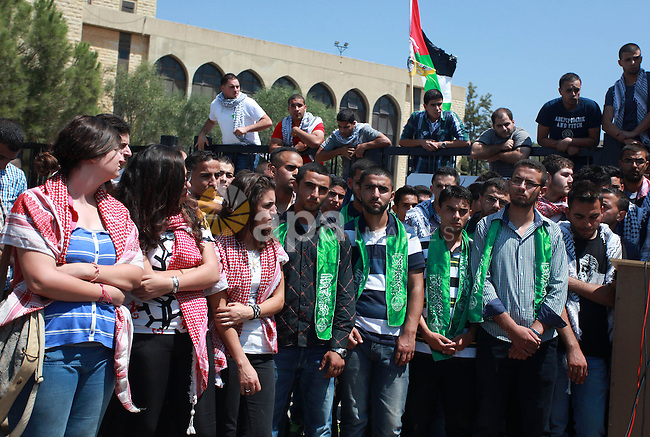 Palestinian students of Birzeit University stand in front of their University as they protest against rising of the tuition fees, near the West Bank City Ramallah, 02 September 2013. Photo by Issam Rimawi