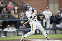 Michigan Wolverines outfielder Miles Lewis (3) swings the bat against the Michigan State Spartans on May 19, 2017 at Ray Fisher Stadium in Ann Arbor, Michigan. Michigan defeated Michigan State 11-6. (Andrew Woolley/Four Seam Images)