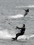 About a half dozen kite boarders  take advantage of temperatures in the 50's and a strong breeze Sunday, January 18, 2015, at Pleasant Bay in South Boston. Herald Photos by Jim Michaud