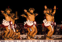 Men performing kahiko hula (ancient form) at the merrie monarch festival, big island of Hawaii