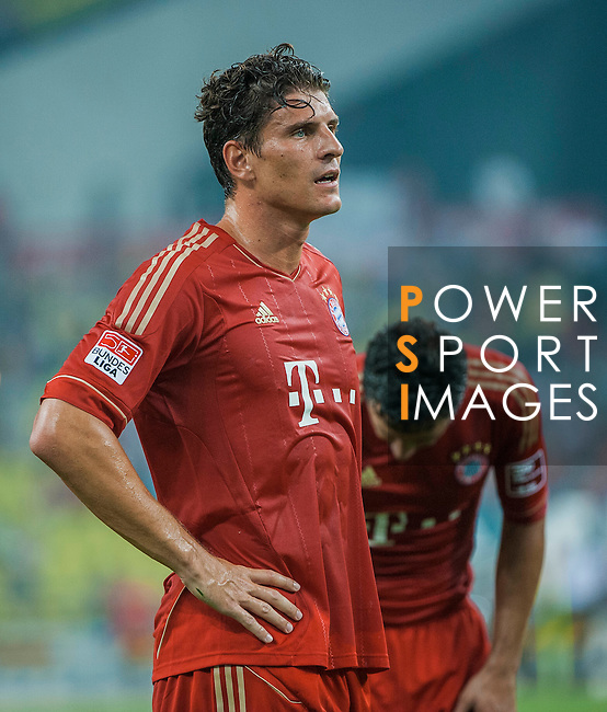 Mario Gomez of Bayern Munich in action during a friendly match against VfL Wolfsburg as part of the Audi Football Summit 2012 on July 26, 2012 at the Guangdong Olympic Sports Center in Guangzhou, China. Photo by Victor Fraile / The Power of Sport Images