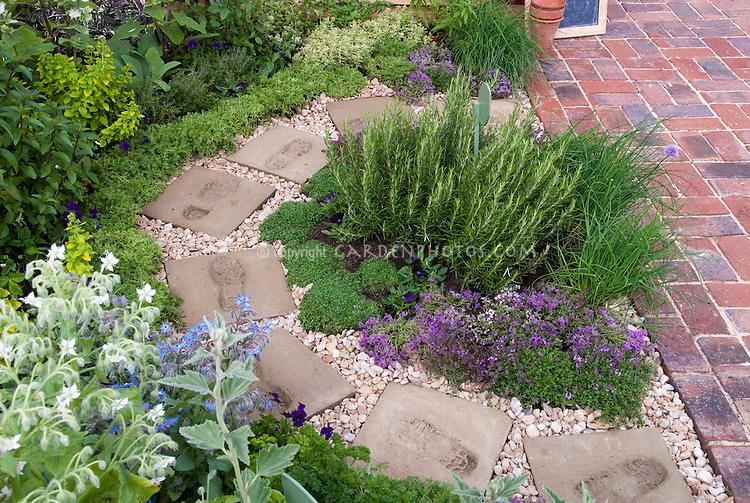 Herb garden circular path patio plant flower stock for Garden designs with stone circles