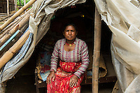 Nepal, Kathmandu Valley, Phutung. Earthquake relief recovery 2015. Women from low caste Dalit community are helped and supported by FEDO, and organization working to better the lives of Dalit women. Through a Global Fund for Women grant they are supporting women from this community who have lost their homes with tents, mattresses, and food since the earthquake. Chameli Accaani, lost her home and lives in water drenched tent. As Dalit, these low caste families are marginalized from the rest of the community.