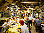 Large dining room at Restaurant Galuppi in the colorful village of Burano, Italy.
