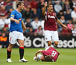 Kevin Thomson tackles Ian Black and the Hearts man writhes in agony