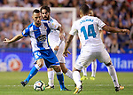 Deportivo de la Coruna's Guilherme Dos Santos (l) and Real Madrid's Isco Alarcon (c) and Carlos Henrique Casemiro during La Liga match. August 20,2017. (ALTERPHOTOS/Acero)