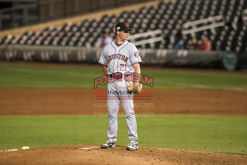 Scottsdale Scorpions relief pitcher Trent Thornton (21), of the Houston Astros organization, looks in for the sign during an Arizona Fall League game against the Salt River Rafters at Salt River Fields at Talking Stick on October 11, 2018 in Scottsdale, Arizona. Salt River defeated Scottsdale 7-6. (Zachary Lucy/Four Seam Images)