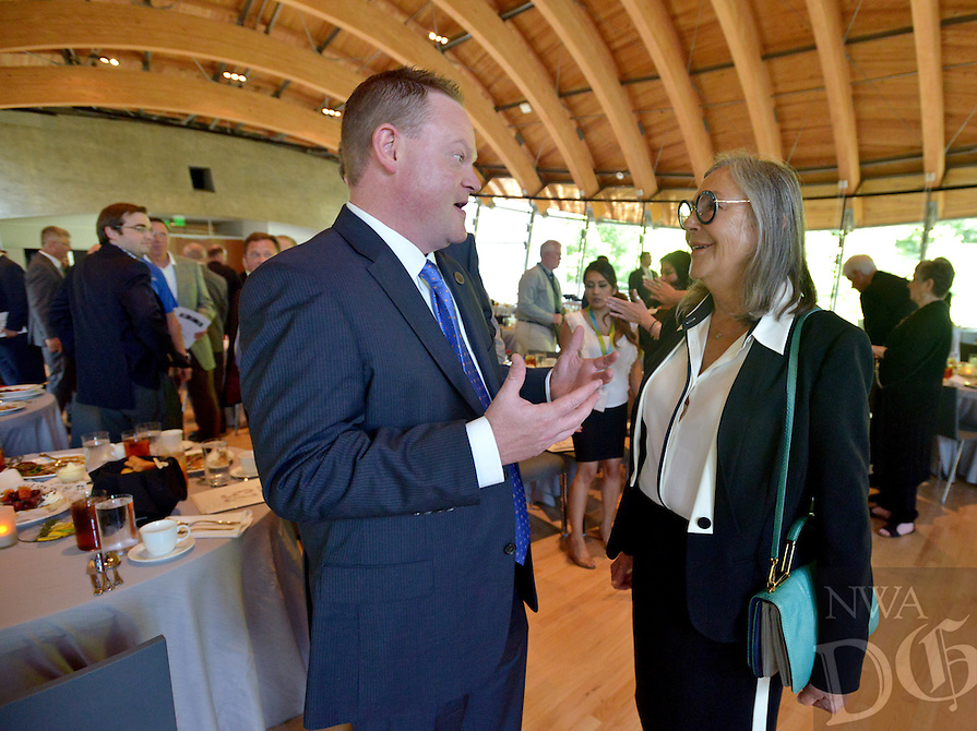 NWA Democrat-Gazette/BEN GOFF &bull; @NWABENGOFF<br /> Greg Hines, Rogers mayor, chats with Alice Walton on Monday July 20, 2015 as the Northwest Arkansas Council celebrates its 25th anniversary at its summer annual meeting at Crystal Bridges Museum of American Art in Bentonville.