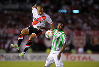 BUENOS AIRES - ARGENTINA - 10-12-2014: Carlos Sanchez (Izq.) jugador de River Plate de Argentina disputa el balon con Farid Diaz (Der.) jugador de Atletico Nacional de Colombia durante partido de vuelta de la final, de la Copa Total Suramericana entre River Plate de Argentina y Atletico Nacional de Colombia en el Estadio Antonio Vespucio Liberti- Monumental de Nuñez, de la ciudad de Buenos Aires.  / Carlos Sanchez (L) player of River Plate of Argentina vies for the ball with con Farid Diaz (R) player Atletico Nacional of Colombia during a match for the second leg of the final, between River Plate of Argentina and Atletico Nacional for the Copa Total Suramericana in the Antonio Vespucio Liberti- Monumental de Nuñez, Stadium, in Buenos Aires city. Photo:  Photogamma / VizzorImage.