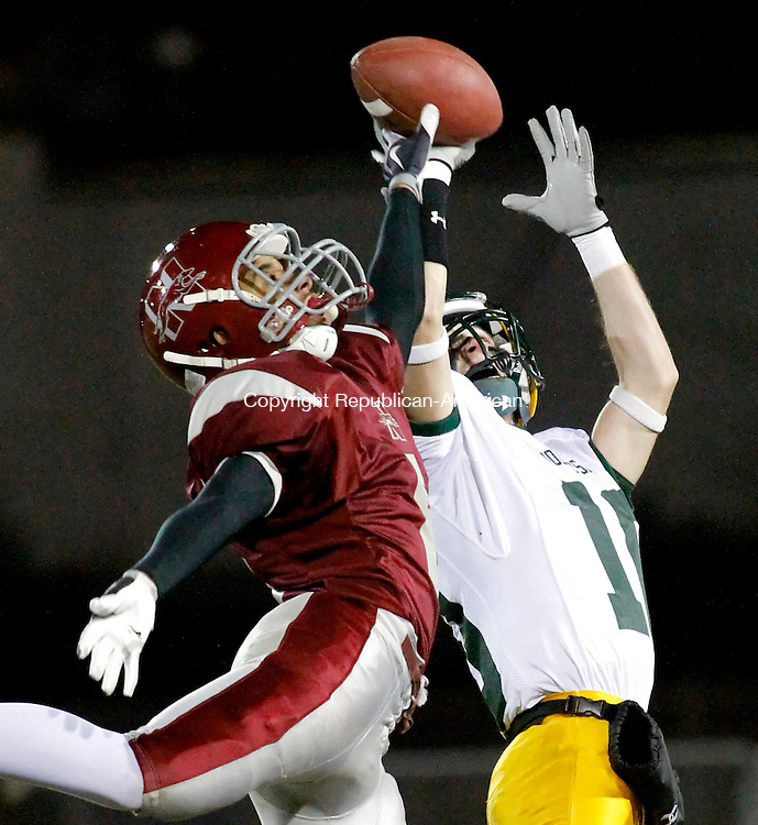 Naugatuck, CT- 12, November 2010-111210CM01 Holy Cross receiver, Matt Czapor (#10) makes the catch as Naugatuck's Jamal Gee defends Friday night in Naugatuck.  The Greyhound's won 24-13, capturing the Copper Division title.  Christopher Massa Republican-American
