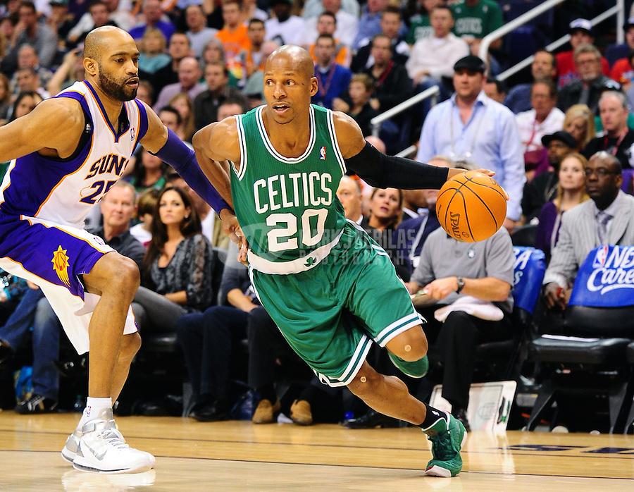 Jan. 28, 2011; Phoenix, AZ, USA; Boston Celtics guard (20) Ray Allen drives to the basket against Phoenix Suns guard Vince Carter at the US Airways Center. Mandatory Credit: Mark J. Rebilas-