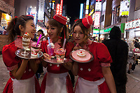 Young Japanese women dressed at waitresses in a diner enjoy the Halloween celebrations in Shibuya. Saturday October 28th 2017
