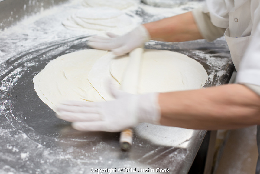 Olga rolls dough for baklava at Kipos in Chapel Hill, N.C. on Thursday, March 13, 2014. (Justin Cook)