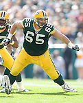 Offensive lineman Mark Tauscher #65 of the Green Bay Packers prepares to block during an NFL football game against the St. Louis Rams at Lambeau Field on October 8, 2006 in Green Bay, Wisconsin. The Rams beat the Packers 23-20. (Photo by David Stluka)