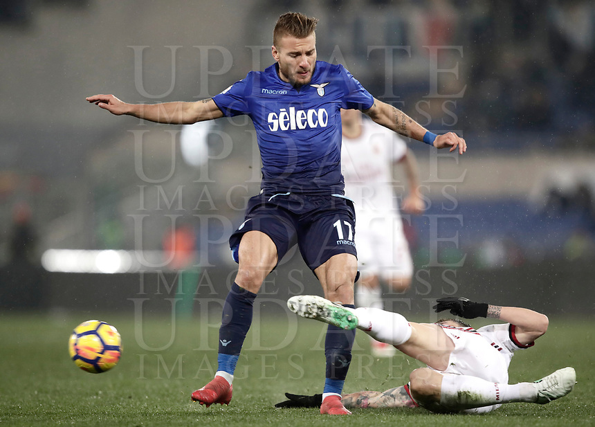 Football Soccer: Tim Cup semi-final second Leg, SS Lazio vs AC Milan, Stadio Olimpico, Rome, Italy, February 28, 2018.<br /> Lazio's Ciro Immobile (l) in action with Milan's Alessio  Romagnoli (r) during the Tim Cup semi-final football match between SS Lazio vs AC Milan, at Rome's Olympic stadium, February 28, 2018.<br /> <br /> UPDATE IMAGES PRESS/Isabella Bonotto