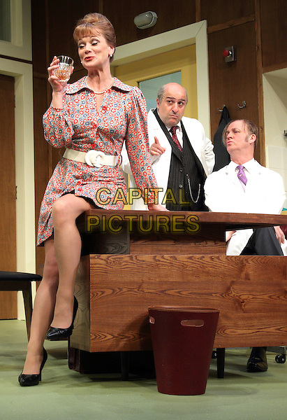 Samantha Bond, Tim McInnerney & Omid Djalili.'What The Butler Saw' at the Vaudeville Theatre, The Strand, London, England..May 9th 2012.stage full length red blue white print dress belt sitting drink beverage white coat desk.CAP/ROS.©Steve Ross/Capital Pictures