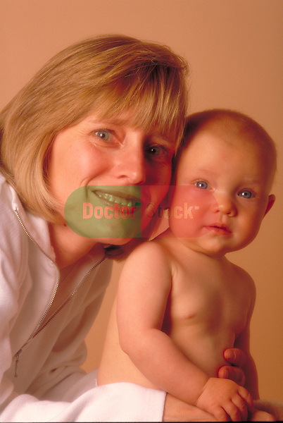 portrait of smiling mother with infant