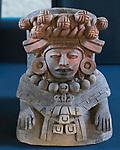 A ceramic effigy of a Zapotec woman from the ruins of the Zapotec city of Atzompa in the Museo Comunitario Santa Maria Atzompa, Oaxaca, Mexico.