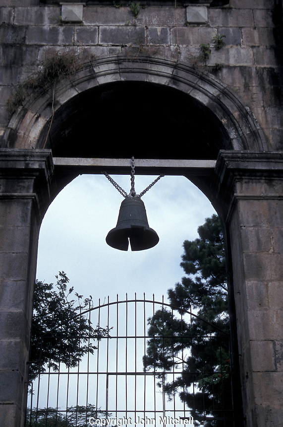Church bell hanging in the entrance to Las Ruinas, a ruined 18th-century church in Cartago, Costa Rica