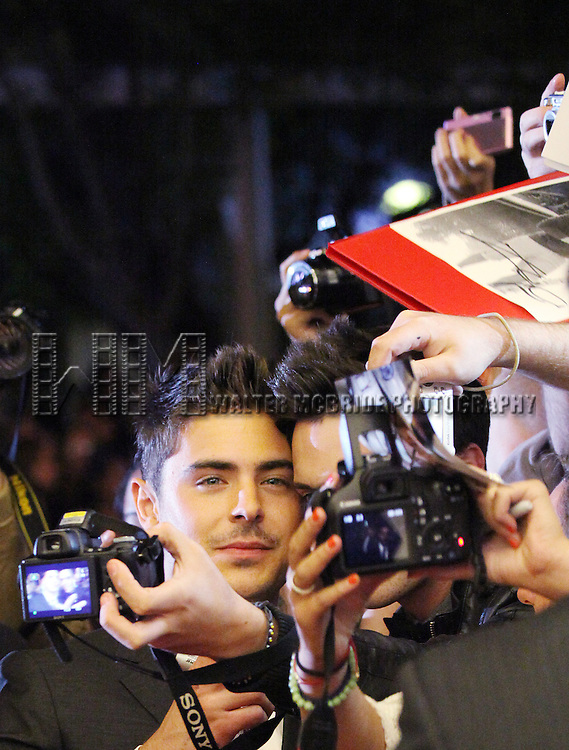 Zac Efron & Fan attending the The 2012 Toronto International Film Festival.Red Carpet Arrivals for 'At Any Price' at the Princess of Wales Theatre in Toronto on 9/9/2012