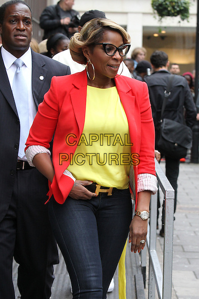 Mary. J. Blige at BBC Radio 1, London, England..June 12th, 2012.half length red blazer yellow top h letter buckle belt jeans denim glasses hoop earrings.CAP/HIL.©John Hillcoat/Capital Pictures.