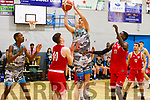 Daire Kennelly of Garveys attempts to shoot for the basket as David Lehane of UCC attempts to block his effort in the U20 Basketball league in the Tralee Sports Complex on Sunday