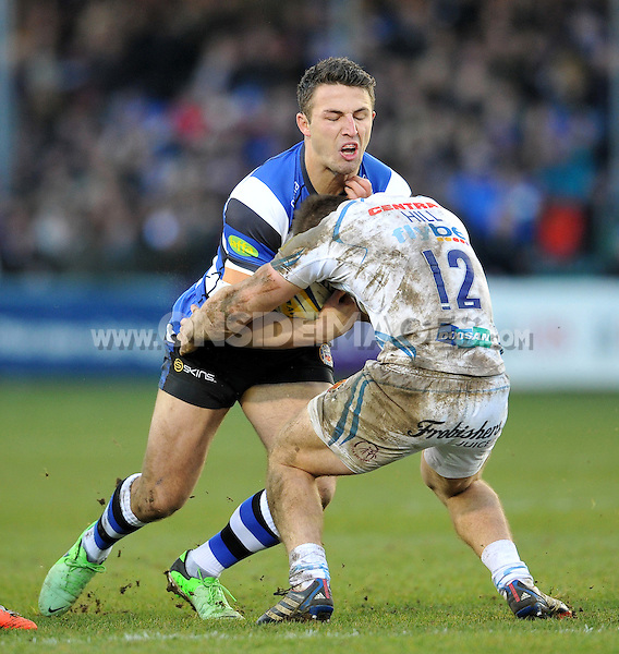 Sam Burgess of Bath Rugby is tackled by Sam Hill of Exeter Chiefs. Aviva Premiership match, between Bath Rugby and Exeter Chiefs on December 27, 2014 at the Recreation Ground in Bath, England. Photo by: Patrick Khachfe / Onside Images