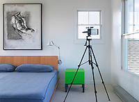 The contemporary bedroom has a telescope for star gazing on clear nights