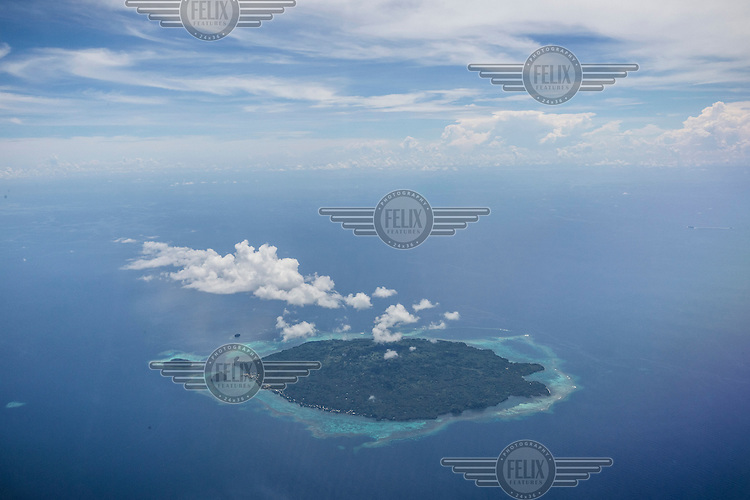 An aerial view of Karkar Island. A study of tropical mountain birds found that they were shifting their ranges upslope to escape warming temperatures. According to the report by Cornell Lab of Ornithology of the U.S. National Academy of Sciences, the activities of industrialised nations that cause climate change are causing birds in remote New Guinea, deep in tropical mountain forests, to move up the slopes to find their preferred habitat. On Karkar Island, 77 percent of all species in the survey moved upslope by an average of 500 feet. Because Karkar and other areas that were studied by the researches are so remote, there has been minimal human development. Researchers believe that climate change is the only major environmental change in those areas. The scientists say that climate change predictions suggest global warming will push at least four of these species into localised extinction by the end of the 21st century.