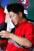 "July 28, 2009:  Starting Pitcher Junichi Tazawa of the Pawtucket Red Sox wipes off the sweat before a game at Coca-Cola Field in Buffalo, NY.  Tazawa was signed out of Japan and making his ""AAA"" debut with Pawtucket, the International League Triple-A affiliate of the Boston Red Sox.  Photo By Mike Janes/Four Seam Images"