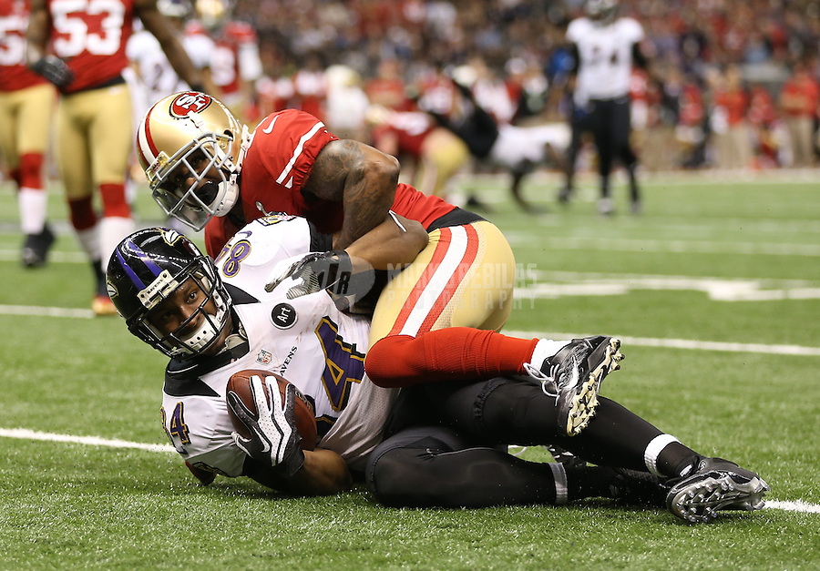 Feb 3, 2013; New Orleans, LA, USA; Baltimore Ravens tight end Ed Dickson (84) is tackled by San Francisco 49ers strong safety Donte Whitner (31) in the second quarter in Super Bowl XLVII at the Mercedes-Benz Superdome. Mandatory Credit: Mark J. Rebilas-