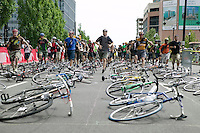 2 July 2005 - Jersey City, NJ, USA - Riders run to their bikes as the start signal is give to a qualifying race for the 13th annual cycle messenger world championships, Jersey City, USA, July 2nd 2005. More than 700 riders from all over the world took part in the 4-day competition which carries event based on the daily work of a city bike messenger.