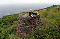 26-7-2015: Weather Humphreys?.....  Minister for Arts, Heritage and the Gaeltacht Heather Humphreys gazes from an old traditional rock cairn at the Cill Rialaigh Famine Village in South Kerry during her visit on Sunday. Minister Humphreys also visited Ballinskelligs overlooking the Skellig Rocks where filming of the next episode of Star Wars is expected to begin this September.<br /> Picture by Don MacMonagle