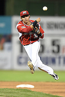 Batavia Muckdogs second baseman Hiram Martinez (15) throws to first during a game against the Lowell Spinners on July 18, 2014 at Dwyer Stadium in Batavia, New York.  Lowell defeated Batavia 11-2.  (Mike Janes/Four Seam Images)