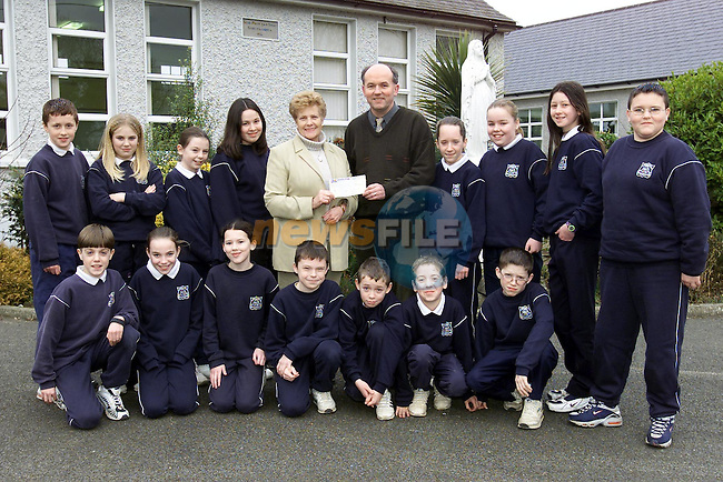 6th Class Cartown National School, Sandpit presenting a cheque with thier teacher Gerry Campbell to Peggy Downey, Area President St. Vincent de Paul. The children raised £172 through a recent bring and buy sale..Picture: Paul Mohan/Newsfile