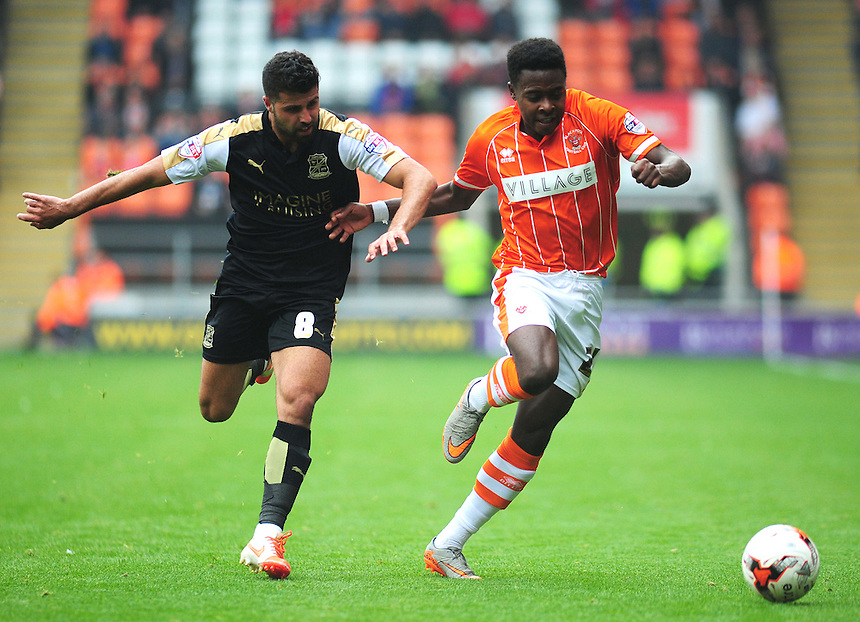 Blackpool's Bright Osayi-Samuel under pressure from Swindon Town's Yaser Kasim <br /> <br /> Photographer Kevin Barnes/CameraSport<br /> <br /> Football - The Football League Sky Bet League One - Blackpool v Swindon Town - Saturday 3rd October 2015 - Bloomfield Road - Blackpool<br /> <br /> &copy; CameraSport - 43 Linden Ave. Countesthorpe. Leicester. England. LE8 5PG - Tel: +44 (0) 116 277 4147 - admin@camerasport.com - www.camerasport.com