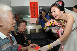 Taiwanese Wedding -- The bride giving a red envelope to her father, as a token of her appreciation for him raising her.
