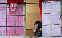 BOGOTA, COLOMBIA - APRIL 25: People ask for food with red rags hanging from their windows on a poor neighborhood in Bogota, on April 25, 2020. Colombian government extended the mandatory preventive quarantine until May 11 on an effort to prevent the spread of Covid-19 pandemic that in the country has infected 5,142 people and caused 233 deaths. (Photo by John Vizcaino/VIEWpress)