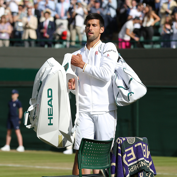 Novak Djokovic of Serbia prepares to leave the court after his defeat by Sam Querrey of USA in their Gentlemen's Singles Third Round match today<br /> <br /> Photographer Stephen White/CameraSport<br /> <br /> Tennis - Wimbledon Lawn Tennis Championships - Day 6 - Saturday 2nd July 2016 -  All England Lawn Tennis and Croquet Club - Wimbledon - London - England<br /> <br /> World Copyright &copy; 2016 CameraSport. All rights reserved. 43 Linden Ave. Countesthorpe. Leicester. England. LE8 5PG - Tel: +44 (0) 116 277 4147 - admin@camerasport.com - www.camerasport.com