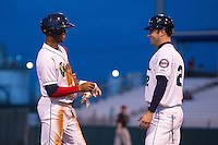 Cedar Rapids Kernels outfielder Byron Buxton #7 laughs with manager Jake Mauer #12 during a game against the Lansing Lugnuts at Veterans Memorial Stadium on April 29, 2013 in Cedar Rapids, Iowa. (Brace Hemmelgarn/Four Seam Images)
