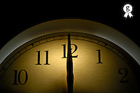 Clock pointing to 12, close up (Licence this image exclusively with Getty: http://www.gettyimages.com/detail/200437373-001 )