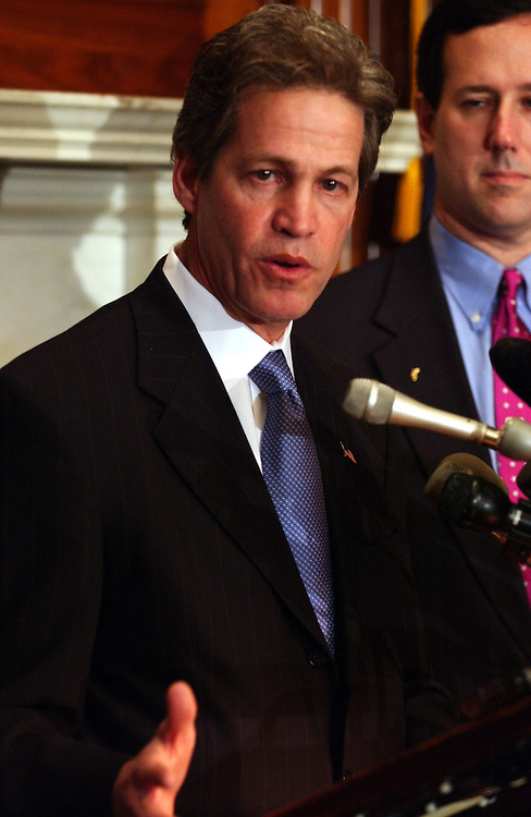 Funding18_040303 --  Norm Coleman, D-Minn., during a news conference to call upon President Bush and the State Department to free up authorized funding for the Iraqi opposition..