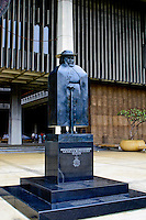 The statue of the renowned  Belgian Priest, Father Damien, stands in tribute at the entrance to Hawaii's state capitol building in downtown Honolulu. Damien was best known for helping sufferers of leprosy on the Kalaupapa peninsula on the island of