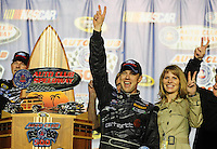 Feb 22, 2009; Fontana, CA, USA; NASCAR Sprint Cup Series driver Matt Kenseth celebrates with wife Katie Kenseth after winning the Auto Club 500 at Auto Club Speedway. Mandatory Credit: Mark J. Rebilas-