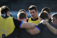 Charlie Ewels looks on in a huddle. Bath Rugby Captain's Run on October 31, 2014 at the Recreation Ground in Bath, England. Photo by: Patrick Khachfe / Onside Images